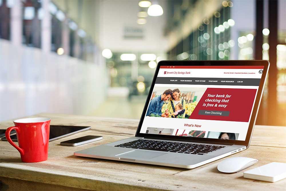 Jewett City Savings Home Page on Laptop